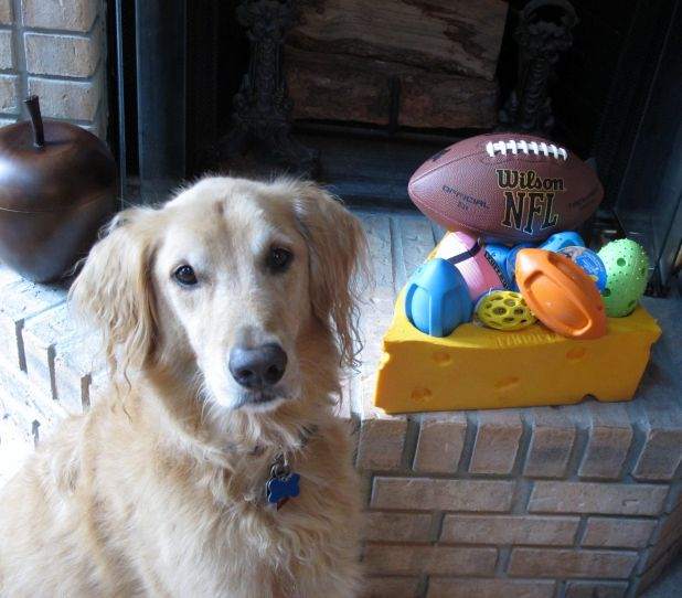 Tanner with Football Prizes.jpg