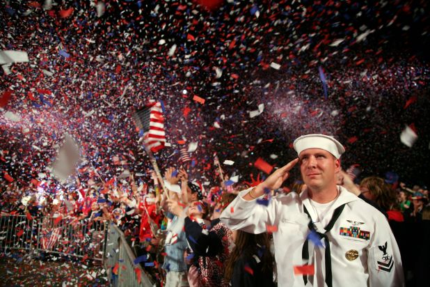 US_Navy_090704-N-3271W-343_Mass_Communication_Specialist_2nd_Class_Scott_Webb_salutes_as_the_America.jpg