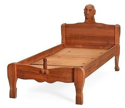carved phallic bed.jpg