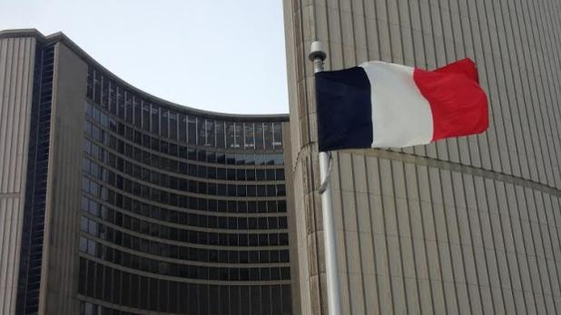 french-flag-flying-at-toronto-city-hall.jpg