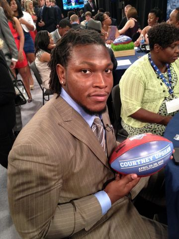Courtney Upshaw at the draft.jpg