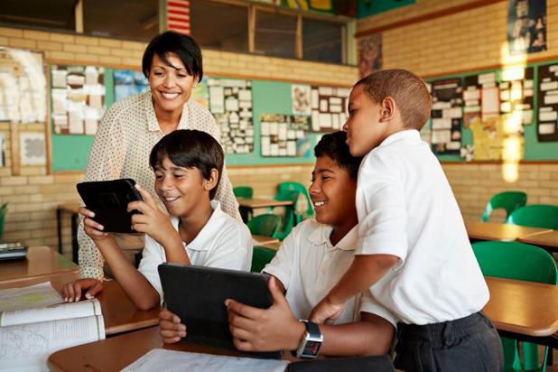 teacher-in-classroom-59f93a2303f4020010b74e98.jpg