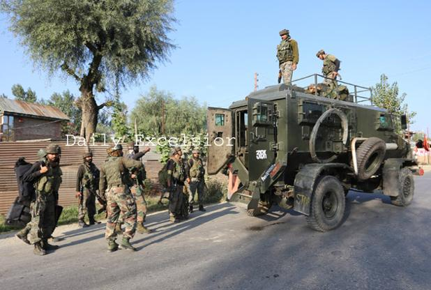 Army personnel move towards the spot where militants were hiding during an encounter    in   Galoora area of  Handwara  in Kupwara district