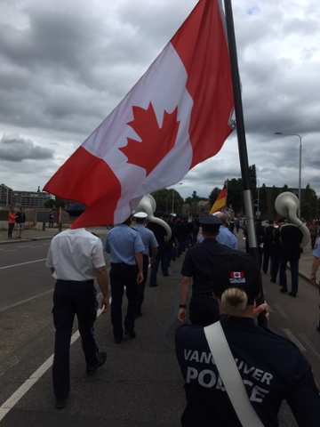 vpd-cst-dureau-leading-canadian-policing-contingent-at-pre-vierdaagse-parade-celebrating-100th-anniversary-females-participating-in-march.pn