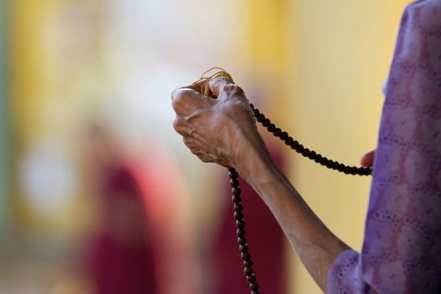 Intrepid-burma_yangoon_buddhist-woman-prays-Michael-Morgan.jpg