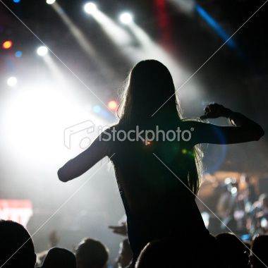 stock-photo-20993018-female-fan-at-the-concert.jpg