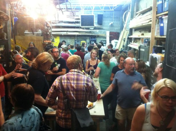 The crowd meets and greets in the Public Theater Props Shop