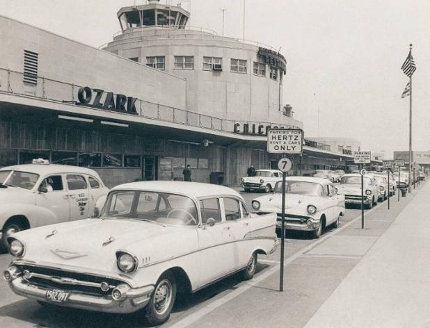 Chuckman_FRONT OF TERMINAL – TAXI – CAR RENTALS PARKED – 1957_MDW.jpg