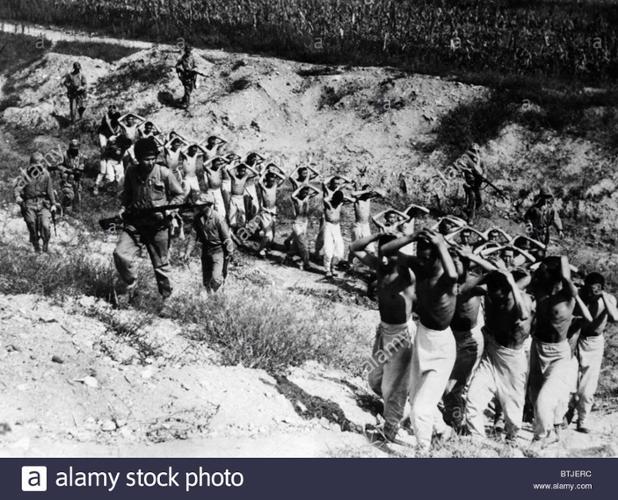 north-korean-prisoners-being-led-to-a-prison-camp-in-south-korea-1953-BTJERC.jpg