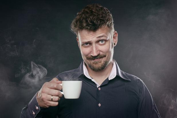 skeptical-man-holding-cup-of-coffee.jpg