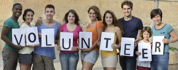 group-standing-with-volunteer-sign-1.jpg