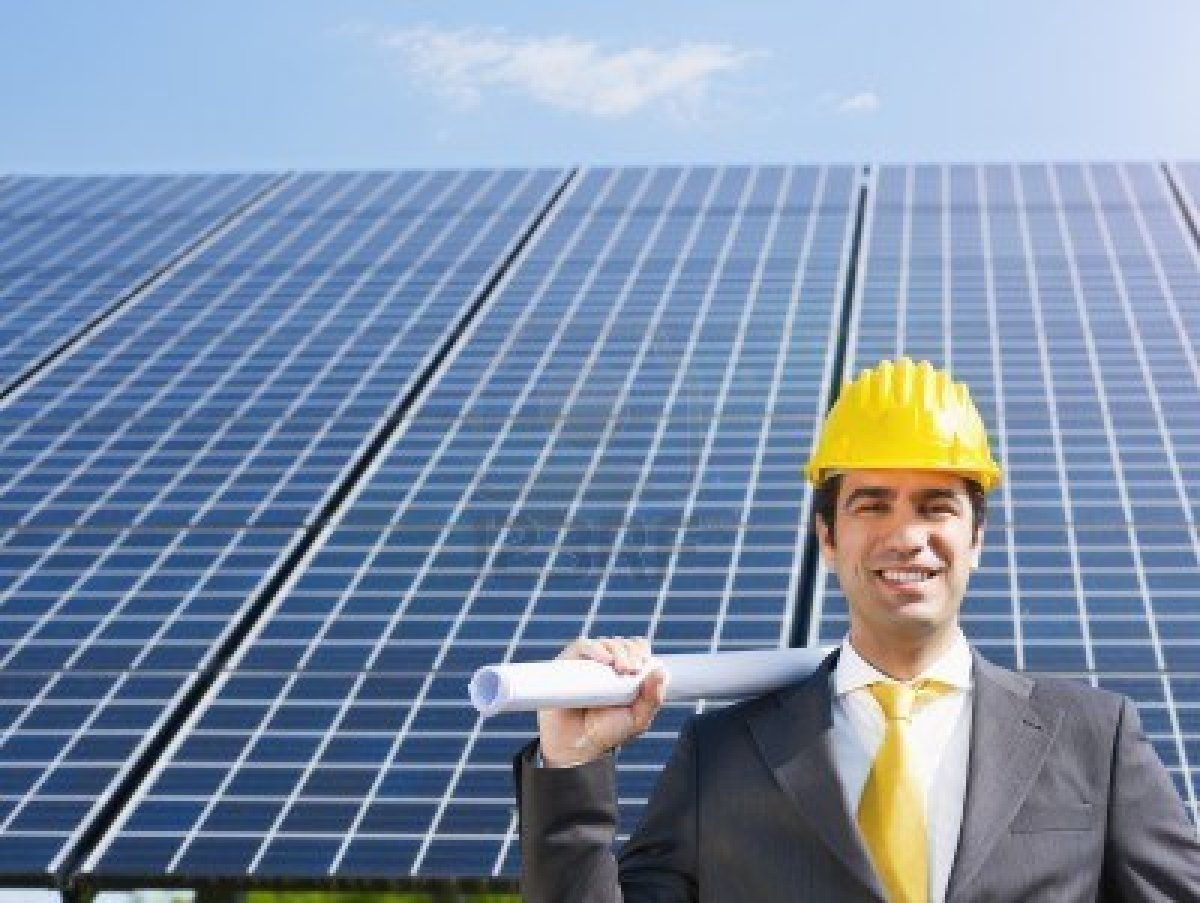 7013218-portrait-of-mid-adult-italian-male-engineer-holding-blueprints-in-solar-power-station-and-sm.jpg
