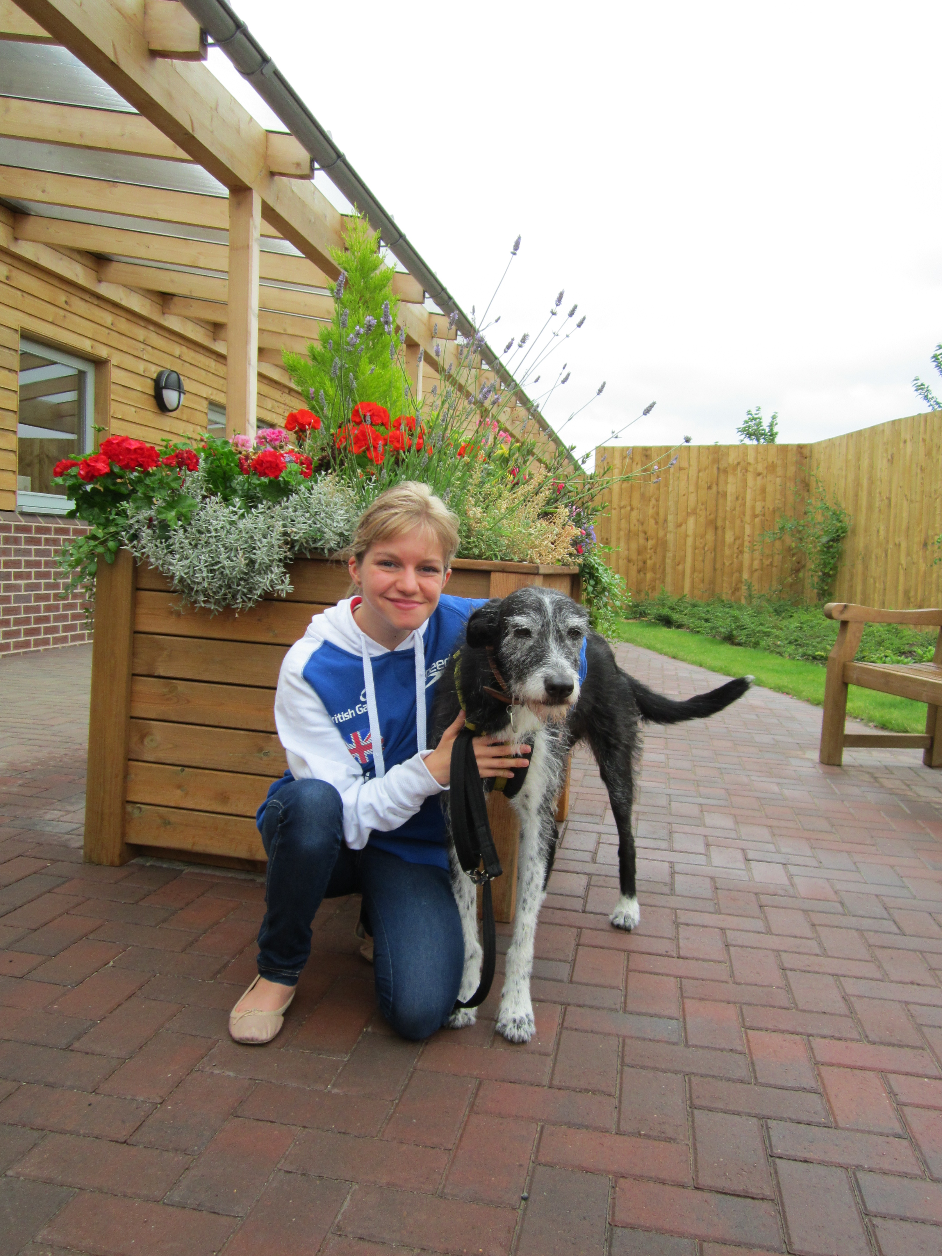 Team GB Paralympic swimmer Emma Hollis meets Bess the Lurcher at Dogs Trust Loughborough.jpg