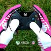 Thumbnail of a photo from user Xbox called NFL_PinkGloves_XboxOne-grass.jpg